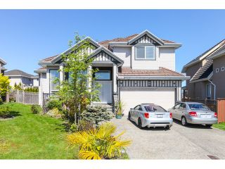 """Photo 1: 14861 74TH Avenue in Surrey: East Newton House for sale in """"CHIMNEY HEIGHTS"""" : MLS®# F1438528"""