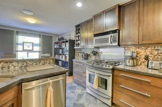 Photo 5: 205 Cranfield Manor SE in Calgary: Cranston Detached for sale : MLS®# A1144624
