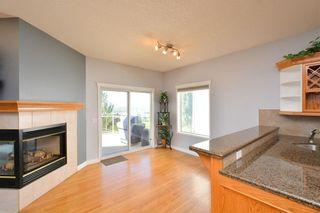 Photo 15: 303 GLENEAGLES View: Cochrane House for sale : MLS®# C4130061