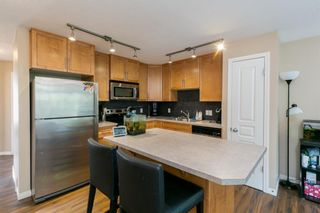 Photo 5: 218 Auburn Bay Square SE in Calgary: Auburn Bay Row/Townhouse for sale : MLS®# A1141951