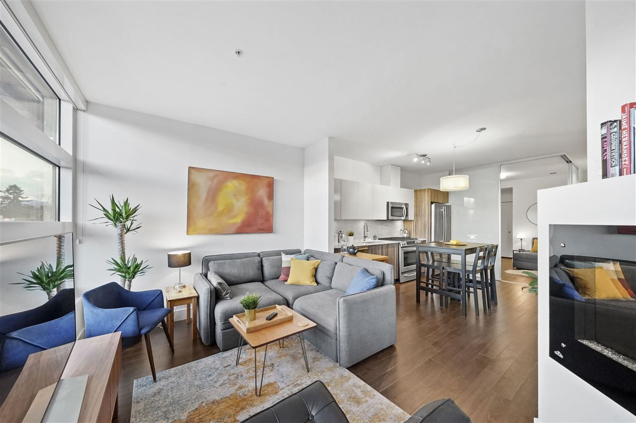 "Main Photo: 318 2250 COMMERCIAL Drive in Vancouver: Grandview Woodland Condo for sale in ""Marquee On The Drive"" (Vancouver East)  : MLS®# R2554745"