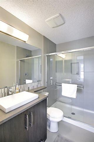 Photo 22: 314 Ascot Circle SW in Calgary: Aspen Woods Row/Townhouse for sale : MLS®# A1111264
