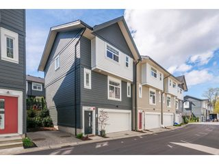 """Photo 1: 76 7665 209 Street in Langley: Willoughby Heights Townhouse for sale in """"Archstone"""" : MLS®# R2359787"""