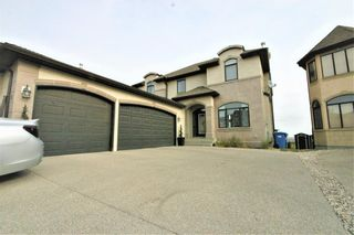 Main Photo: 36 Coulee Park SW in Calgary: Cougar Ridge Detached for sale : MLS®# A1148371