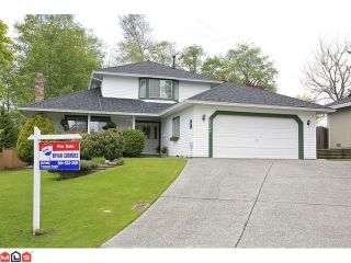 Photo 1: 18049 63RD Avenue in Surrey: Cloverdale BC House for sale (Cloverdale)  : MLS®# F1211606