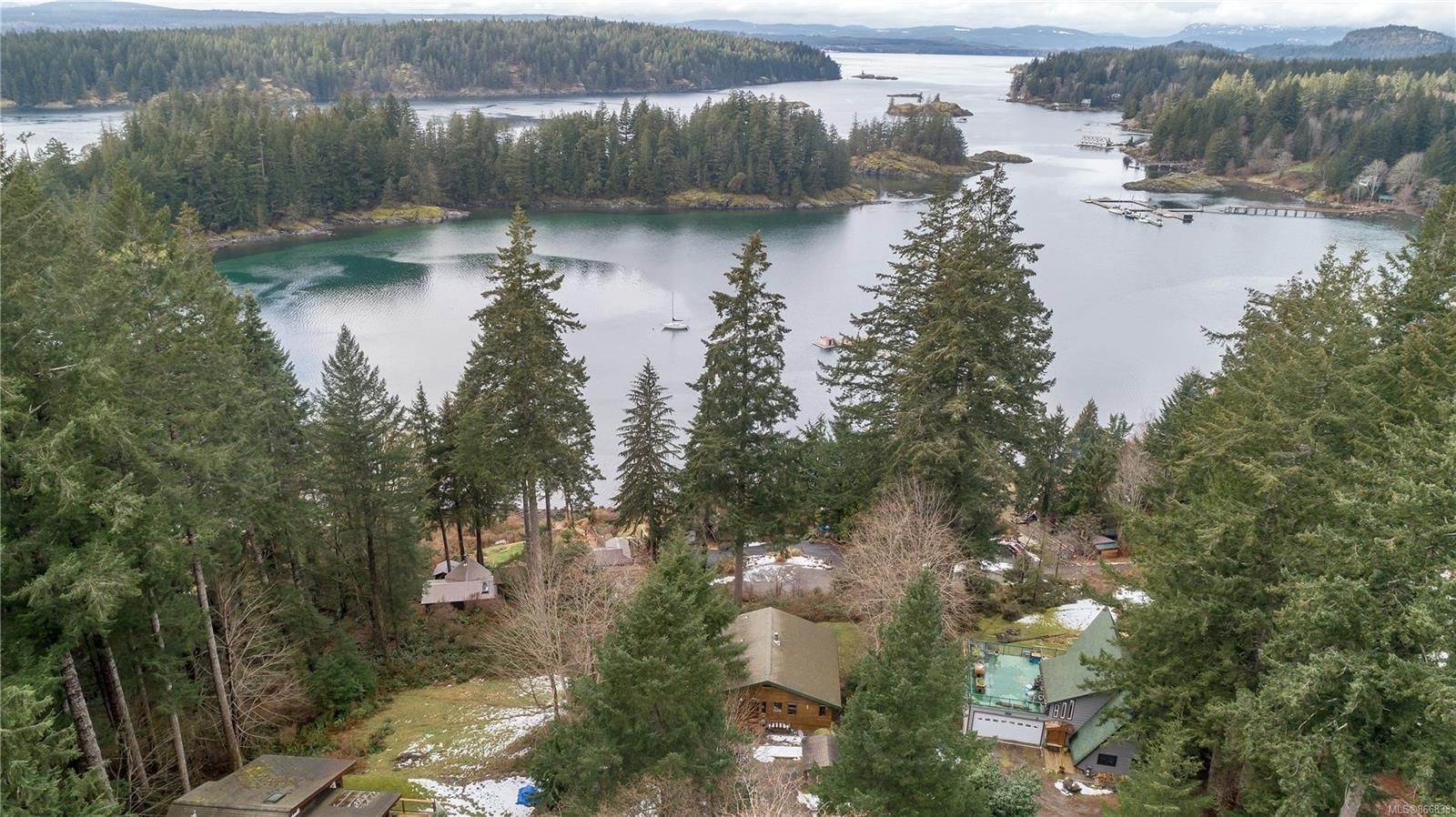 Quadra Island ocean view home, with a 2 bedroom 1 bathroom suite on the lower floor and beautiful views across Gowlland Harbour!