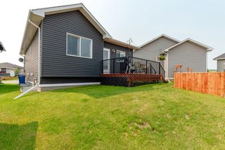 Photo 29: 633 Country Meadows Close: Turner Valley Detached for sale : MLS®# A1130452