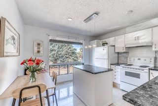 Photo 2: 26 5019 46 Avenue SW in Calgary: Glamorgan Row/Townhouse for sale : MLS®# A1147029