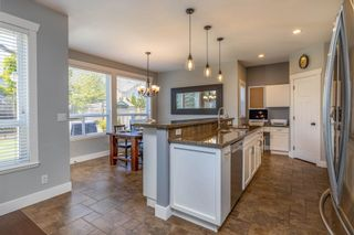 """Photo 12: 7021 195A Street in Surrey: Clayton House for sale in """"Clayton"""" (Cloverdale)  : MLS®# R2594485"""