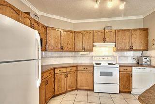 Photo 14: 50 Edgeridge Terrace NW in Calgary: Edgemont Row/Townhouse for sale : MLS®# A1111203