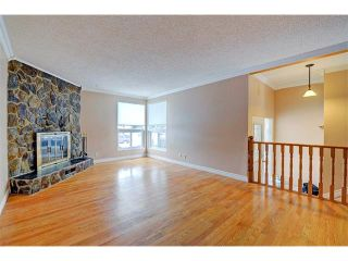 Photo 11: 6415 LONGMOOR Way SW in Calgary: Lakeview House for sale : MLS®# C4102401
