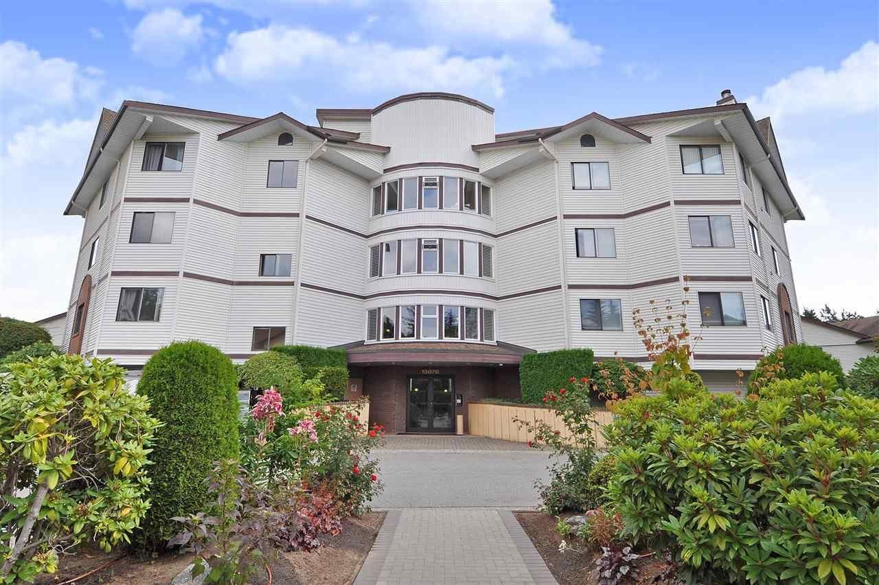 Main Photo: 404 13876 102 AVENUE in Surrey: Whalley Condo for sale (North Surrey)  : MLS®# R2396892