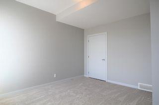 Photo 5: 296 Silverado Plains Park SW in Calgary: Silverado Row/Townhouse for sale : MLS®# A1065666