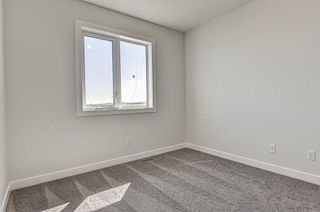 Photo 22: 132 Creekside Drive SW in Calgary: C-168 Semi Detached for sale : MLS®# A1098272