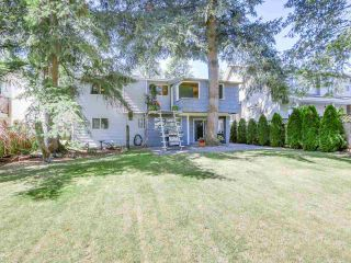 """Photo 1: 2232 MADRONA Place in Surrey: King George Corridor House for sale in """"West of King George"""" (South Surrey White Rock)  : MLS®# R2202364"""
