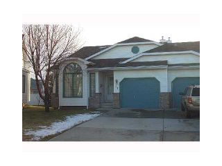 Photo 1: 66 RIVERCREST Villa SE in Calgary: Riverbend Residential Attached for sale : MLS®# C3648564