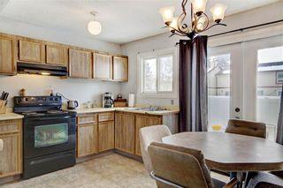 Photo 6: 203 DEERPOINT Lane SE in Calgary: Deer Ridge Row/Townhouse for sale : MLS®# C4288291