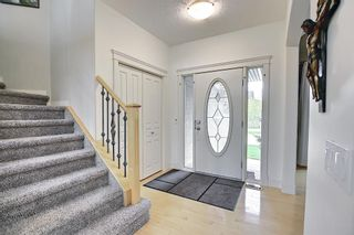 Photo 2: 12 Strathlea Place SW in Calgary: Strathcona Park Detached for sale : MLS®# A1114474