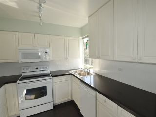 """Photo 9: 408 1445 MARPOLE Avenue in Vancouver: Fairview VW Condo for sale in """"HYCROFT TOWERS"""" (Vancouver West)  : MLS®# R2047974"""
