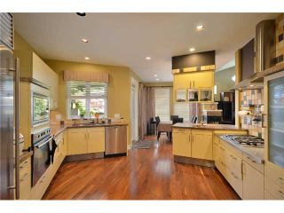Photo 4: 4825 BARKER Crescent in Burnaby: Garden Village House for sale (Burnaby South)  : MLS®# V902284