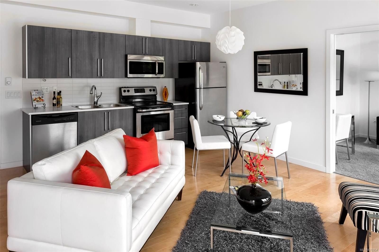 Clean, modern open concept living area. All furniture and decor is included!