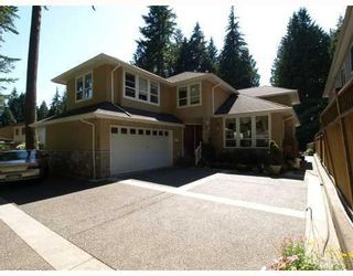 Photo 1: 4939 Capilano Road in North Vancouver: Canyon Heights NV House for sale : MLS®# V775746