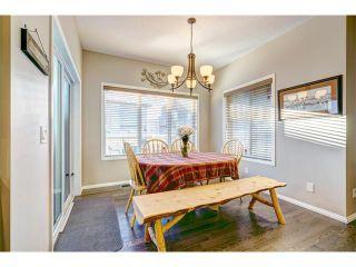 Photo 7: 109 HEARTLAND Way: Cochrane House for sale : MLS®# C4044449