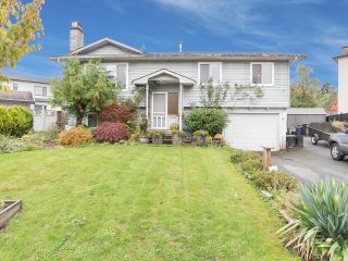 Photo 1: 13388 CYPRESS Place in Surrey: Queen Mary Park Surrey House for sale : MLS®# R2624139