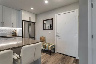 Photo 2: 208 8530 8A Avenue SW in Calgary: West Springs Apartment for sale : MLS®# A1110746
