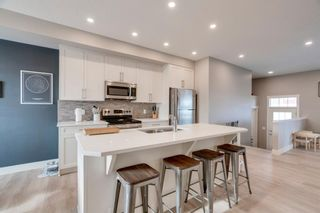 Photo 5: 678 Cranford Walk SE in Calgary: Cranston Row/Townhouse for sale : MLS®# A1066277