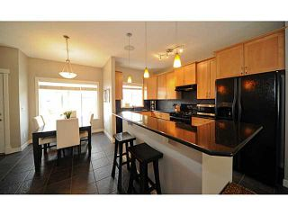 Photo 4: 90 COUGARTOWN Circle SW in CALGARY: Cougar Ridge Residential Detached Single Family for sale (Calgary)  : MLS®# C3522598