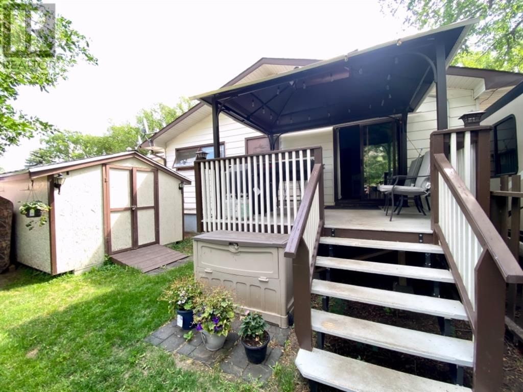 Main Photo: 415 3A Street W in Brooks: House for sale : MLS®# A1129371