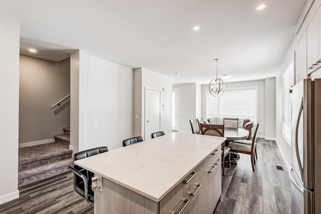 Photo 8: Photos: 125 Redstone Crescent NE in Calgary: Redstone Row/Townhouse for sale : MLS®# A1124721