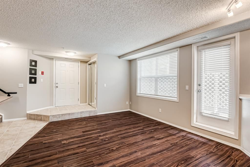 Main Photo: 106 6600 Old Banff Coach Road SW in Calgary: Patterson Apartment for sale : MLS®# A1142616