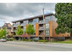 Main Photo: 206 2267 PITT RIVER Road in Port Coquitlam: Central Pt Coquitlam Condo for sale : MLS®# R2576631