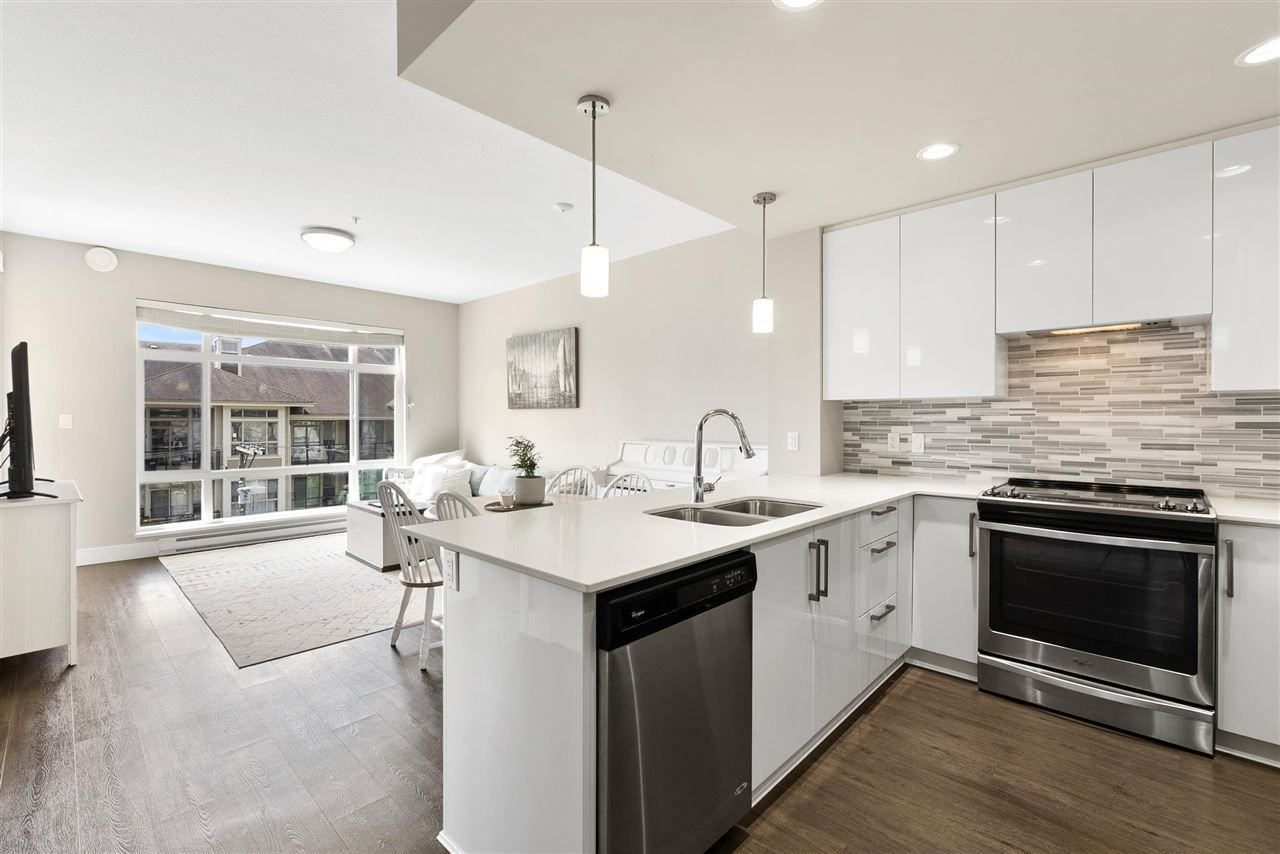 """Main Photo: 401 2495 WILSON Avenue in Port Coquitlam: Central Pt Coquitlam Condo for sale in """"Orchid Riverside Condos"""" : MLS®# R2579450"""