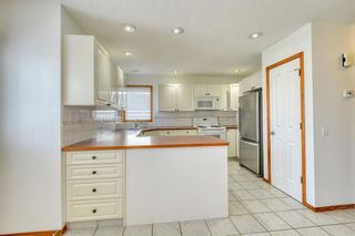 Photo 13: 12 West Hall Place: Cochrane Detached for sale : MLS®# A1119224