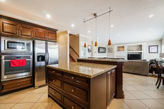 """Photo 10: 7160 150TH Street in Surrey: East Newton House for sale in """"SULLIVAN MEADOWS"""" : MLS®# R2612211"""