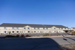 Photo 1: : Strathmore Hotel/Motel for sale : MLS®# A1058562