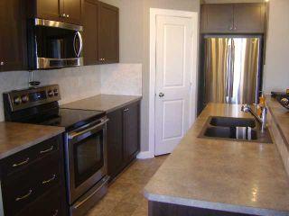 Photo 5: 19 WESTRIDGE Green: Okotoks Residential Detached Single Family for sale : MLS®# C3508559