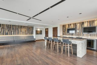 Photo 31: 412 619 Confluence Way SE in Calgary: Downtown East Village Apartment for sale : MLS®# A1118938