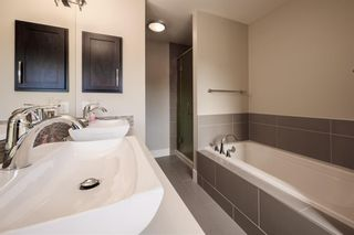 Photo 18: 524 Quarry Park Boulevard SE in Calgary: Douglasdale/Glen Row/Townhouse for sale : MLS®# A1084098