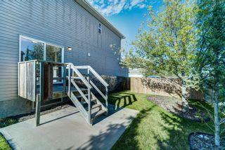 Photo 44: 4 136 Bow Ridge Drive: Cochrane Row/Townhouse for sale : MLS®# A1116097