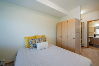 Photo 13: 101 72 Quigley Drive: Cochrane Apartment for sale : MLS®# A1091486