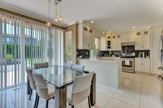 """Photo 13: 7439 146 Street in Surrey: East Newton House for sale in """"Chimney Heights"""" : MLS®# R2602834"""