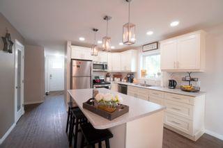 Photo 3: 29 10th ST NE in Portage la Prairie: House for sale : MLS®# 202120303
