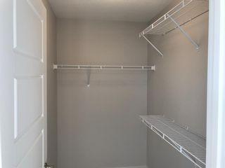 Photo 37: 23 Sunrise Heights: Cochrane Duplex for sale : MLS®# A1017998