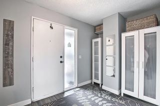 Photo 2: 104 7172 Coach Hill Road SW in Calgary: Coach Hill Row/Townhouse for sale : MLS®# A1097069