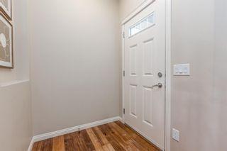 Photo 4: 20 Sunrise View: Cochrane Detached for sale : MLS®# A1019630