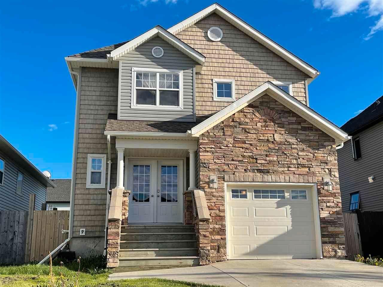 "Main Photo: 8619 113A Avenue in Fort St. John: Fort St. John - City NE House for sale in ""PANORAMA RIDGE"" (Fort St. John (Zone 60))  : MLS®# R2560781"